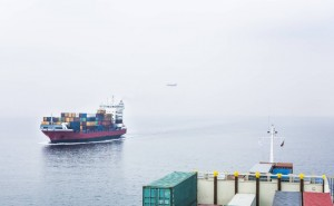 Germany Hamburg Container ship with aeroplane in background property released PUBLICATIONxINxGERxS